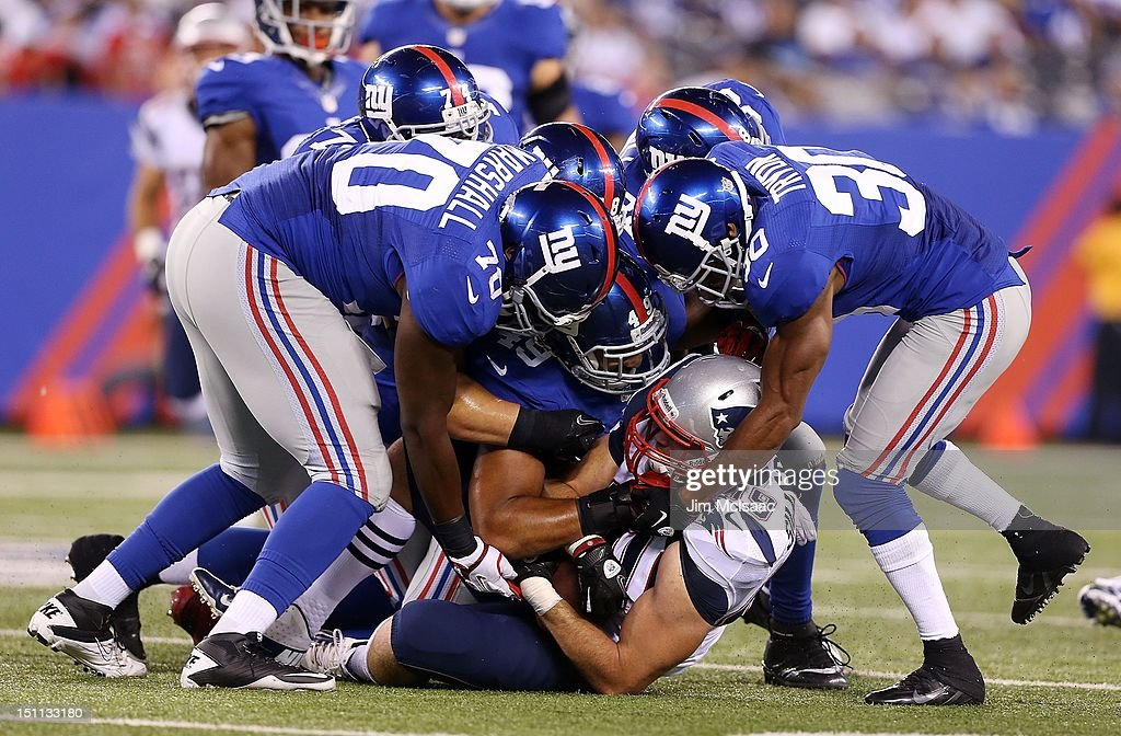 Craig Marshall Justin Tryon and Spencer Paysinger of the New York Giants in action against Alex Silvestro of the New England Patriots at MetLife...