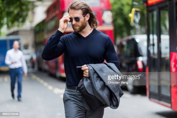 Craig McGinlay wearing a navy longshirt during the London Fashion Week Men's June 2017 collections on June 12 2017 in London England