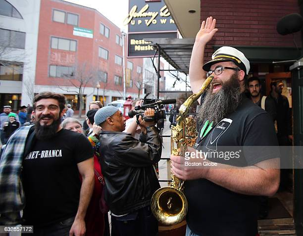 Craig McKeone former bartender and musician waves goodbye to Johnny D's on its last day in business in Somerville MA on Mar 13 2016