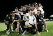 Craig McMillan holds the ChappellHadlee trophy while the captain Stephen Fleming of the New Zealand cricket team holds the National Bank One Day Cup...