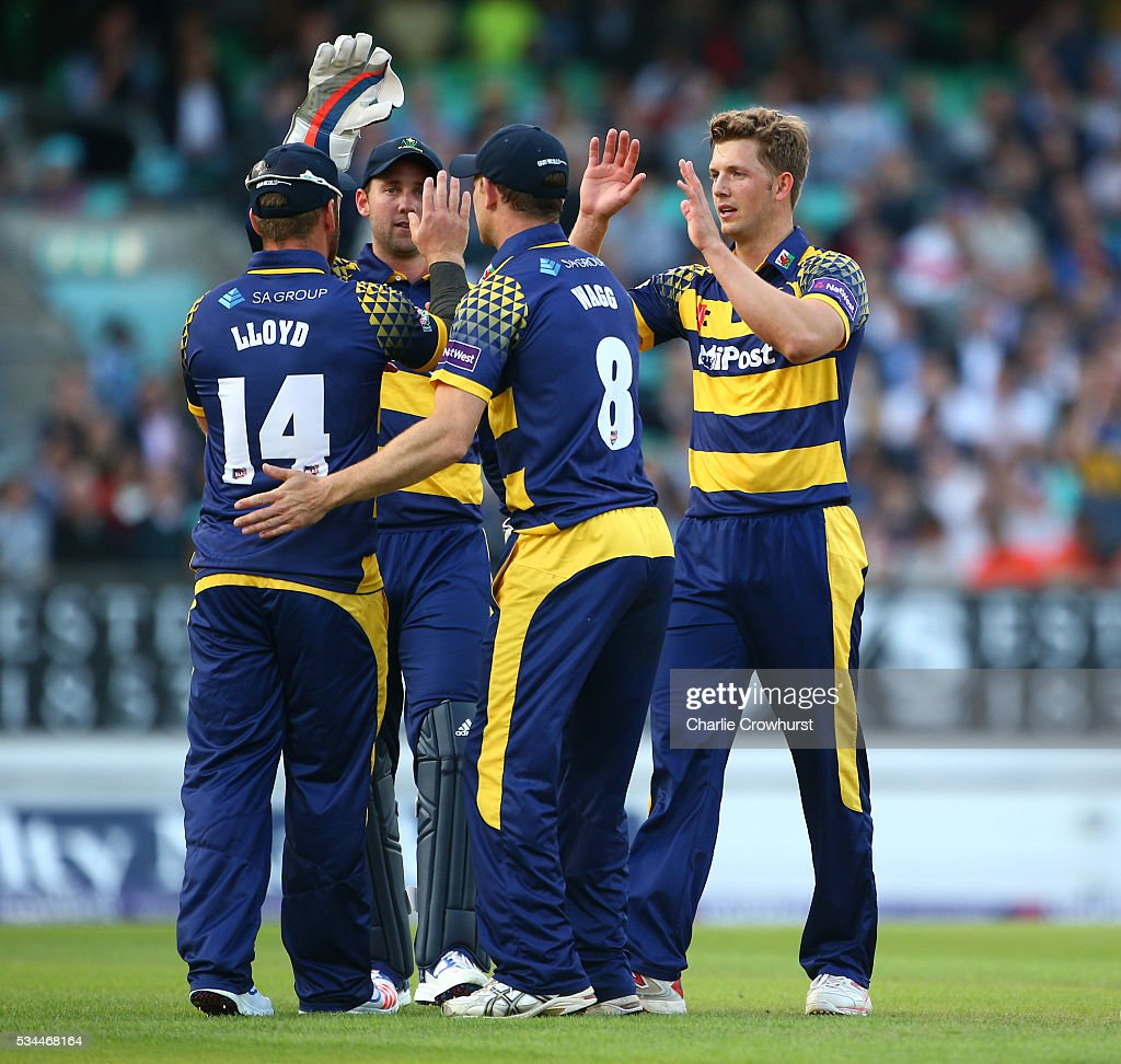 Craig Meschede of Glamorgan (R) celebrates with team mates after taking the wicket of Surrey's Sam Curran during the Natwest T20 Blast match between Surrey and Glamorgan at The Kia Oval on May 26, 2016 in London, England.