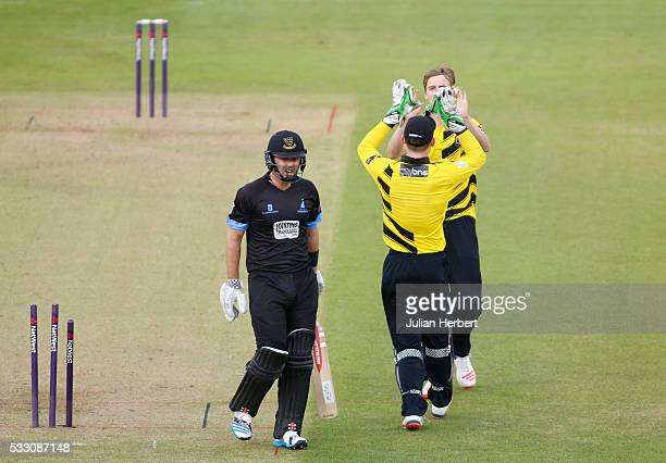 Craig Miles and Cameron Bancroft of Gloucestershire celebrate the wicket of Chris Nash of Sussex Sharks during the NatWest T20 Blast match between...