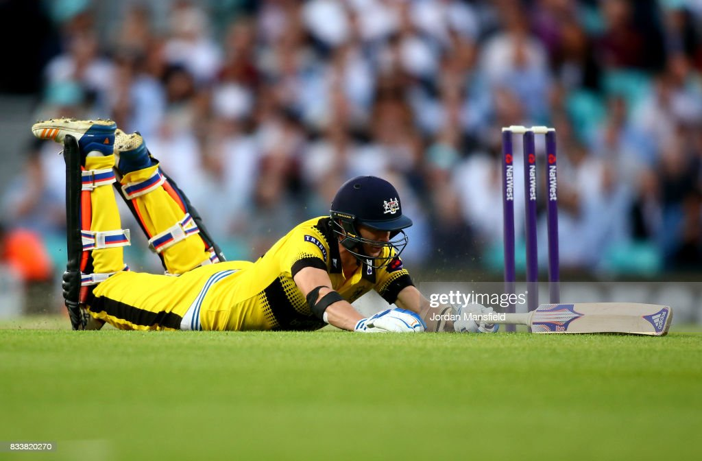 Craig Miles of Gloucestershire dives to make his ground during the NatWest T20 Blast match between Surrey and Gloucestershire at The Kia Oval on August 17, 2017 in London, England.