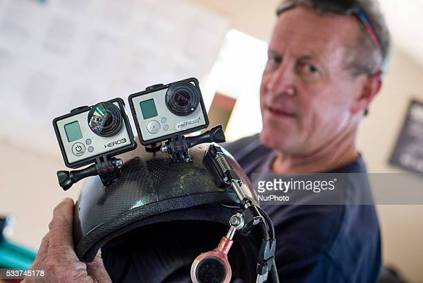 Craig Milne a leader of the Ground Rush Adventures dropzone prepares special helmet for filming his customers during their skydiving at Swakopmund...