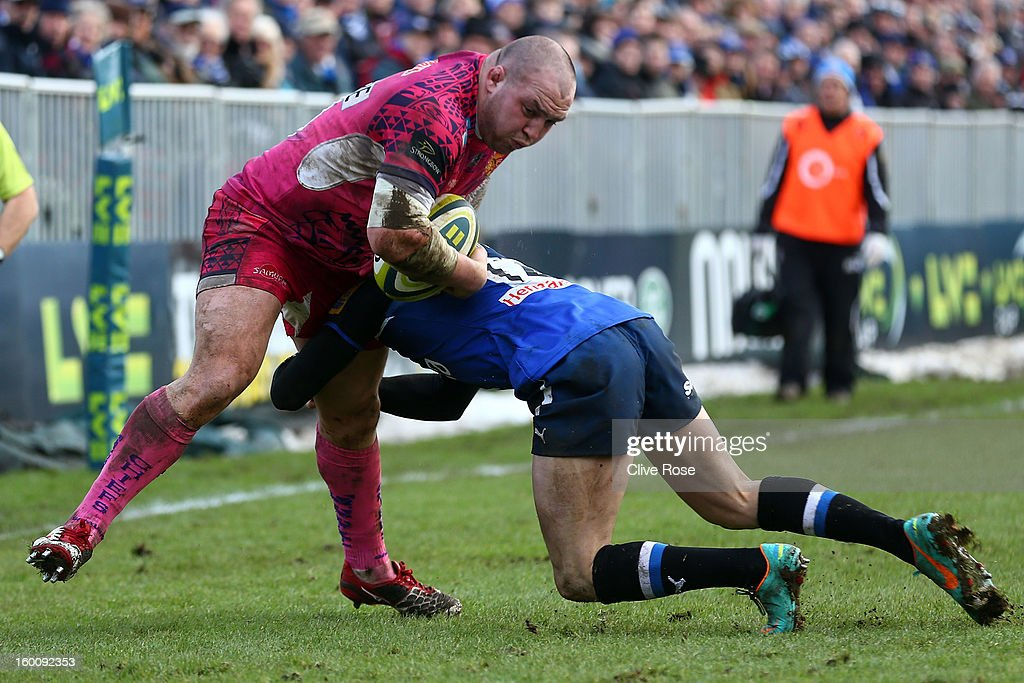 Craig Mitchell of Exeter Chiefs is tackled by Sam Hill of Bath during the LV= Cup match between Bath and Exeter Chiefs at the Recreation Ground on January 26, 2013 in Bath, England.