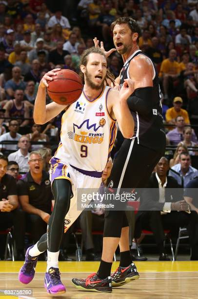 Craig Moller of the Kings is fouled by David Anderson of United during the round 18 NBL match between the Sydney Kings and Melbourne United at Qudos...