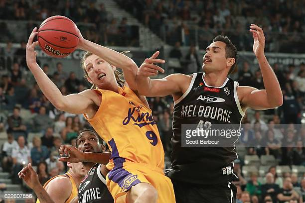 Craig Moller of the Sydney Kings and Tai Wesley of Melbourne United compete for the ball during the round six NBL match between Melbourne United and...