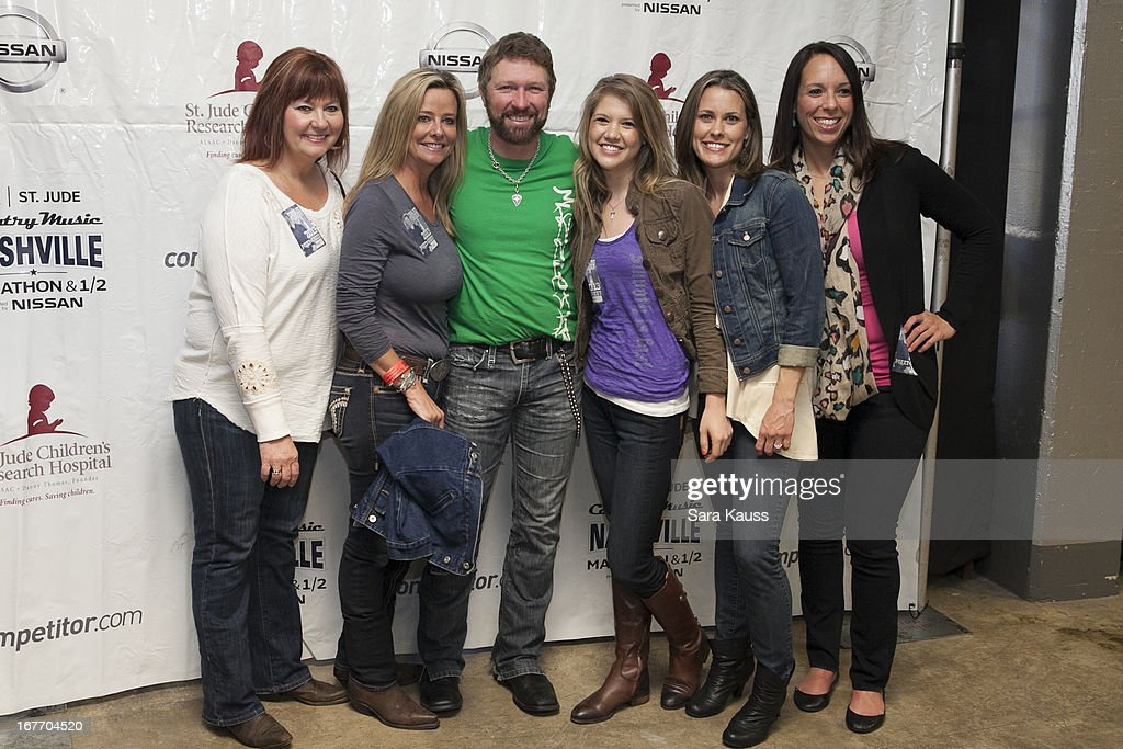 Craig Morgan (3rd L) and fans attend the St Jude Country Music Marathon and Half Marathon Post Race Concert presented by Nissan on April 27, 2013 in Nashville, Tennessee.