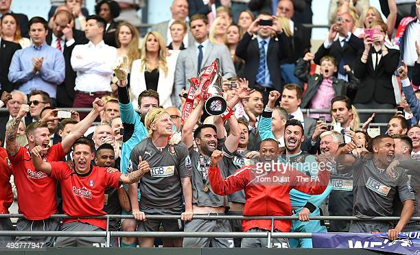 Craig Morgan of Rotherham United lifts the trophy during the Sky Bet League One Playoff Final match between Leyton Orient and Rotherham United at...