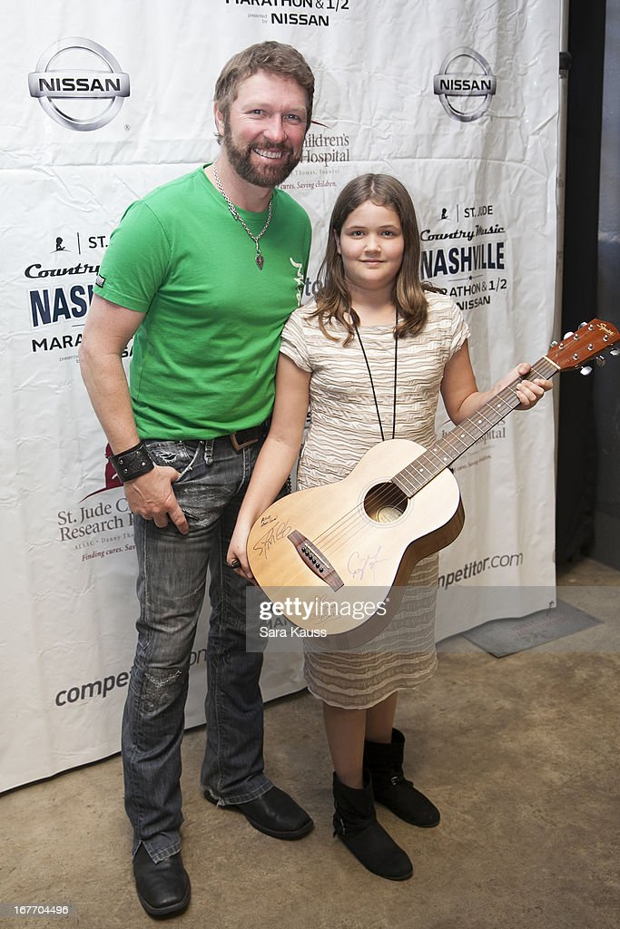 Craig Morgan (L) poses with a fan as he attends the St Jude Country Music Marathon and Half Marathon Post Race Concert presented by Nissan on April 27, 2013 in Nashville, Tennessee.
