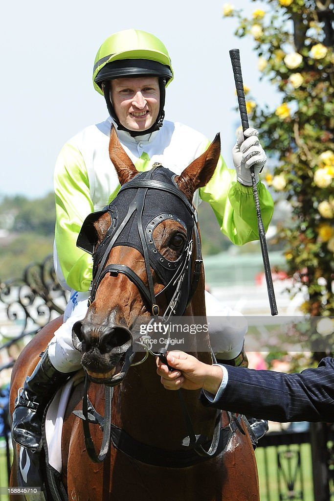 Craig Newitt riding Module after winning the Bagot Handicap during Melbourne Racing at Flemington Racecourse on January 1, 2013 in Melbourne, Australia.