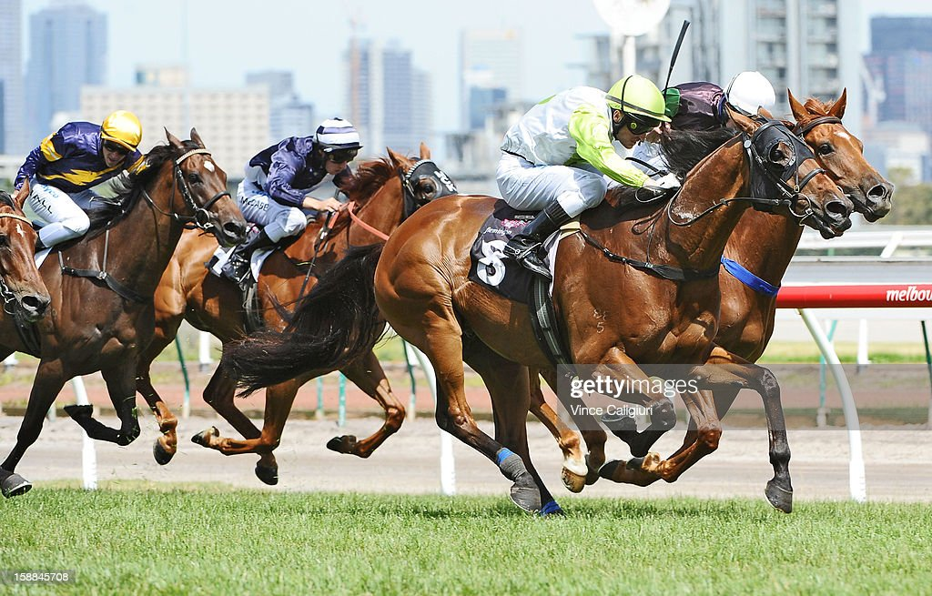 Craig Newitt riding Module wins the Bagot Handicap during Melbourne Racing at Flemington Racecourse on January 1, 2013 in Melbourne, Australia.