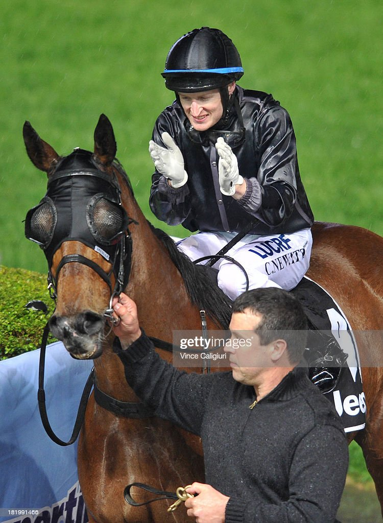 Craig Newitt riding Mourinho applauds after winning the Alternate Railway JRA Cup during Moonee Valley Racing at Moonee Valley Racecourse on September 27, 2013 in Melbourne, Australia.