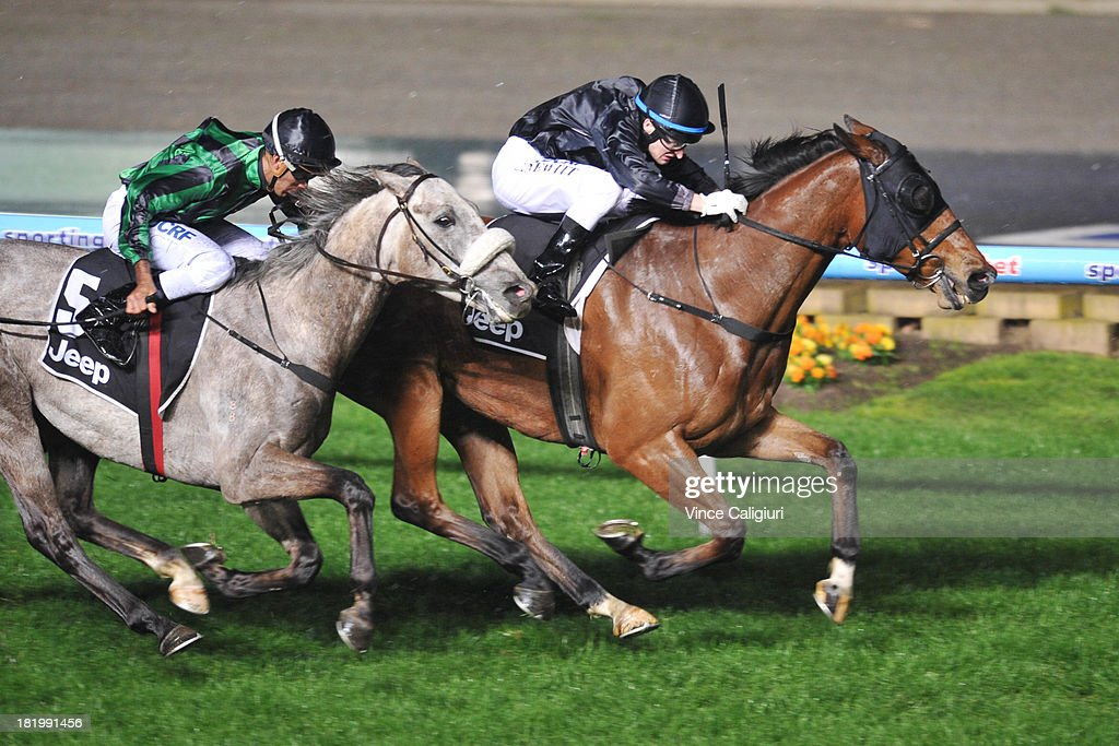 Craig Newitt riding Mourinho defeats Dom Tourneur riding Gris Caro in the Alternate Railway JRA Cup during Moonee Valley Racing at Moonee Valley Racecourse on September 27, 2013 in Melbourne, Australia.