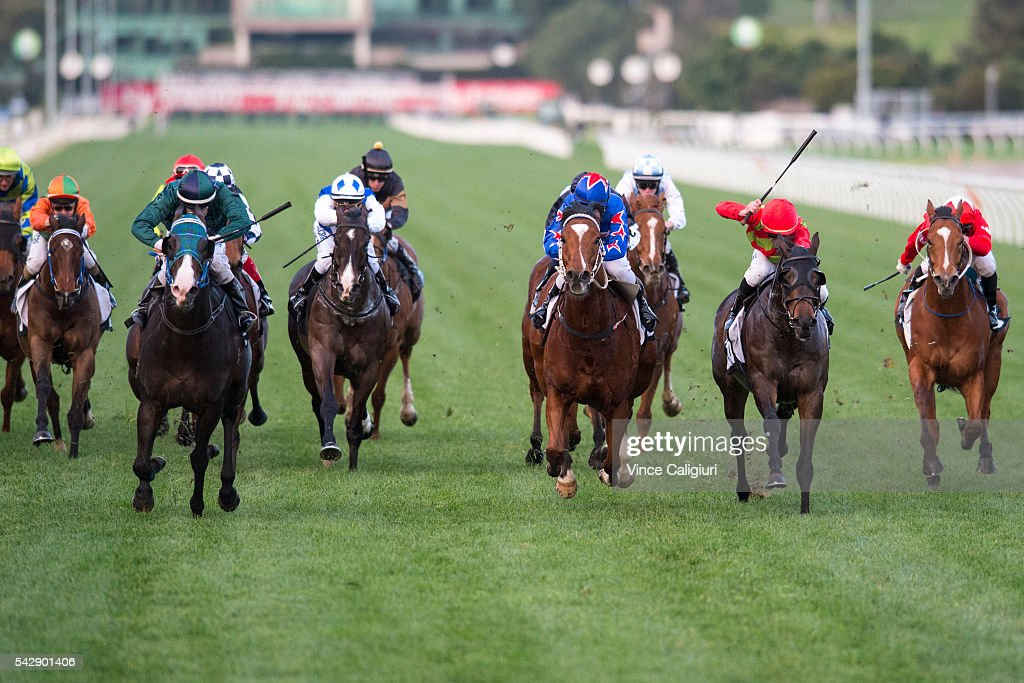 Craig Newitt riding Odyssey Moon (green) wins Race 9, during Melbourne Racing at Flemington Racecourse on June 25, 2016 in Melbourne, Australia.