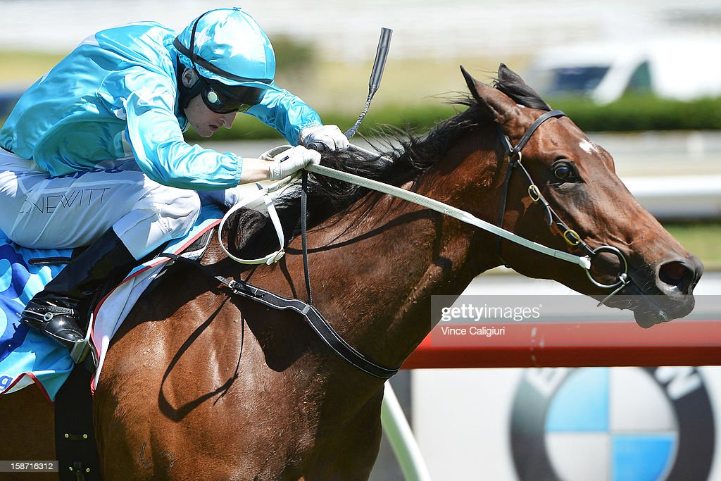 Craig Newitt riding Tariana wins the Ken Sturt Handicap at Caulfield Racecourse on December 26, 2012 in Melbourne, Australia.