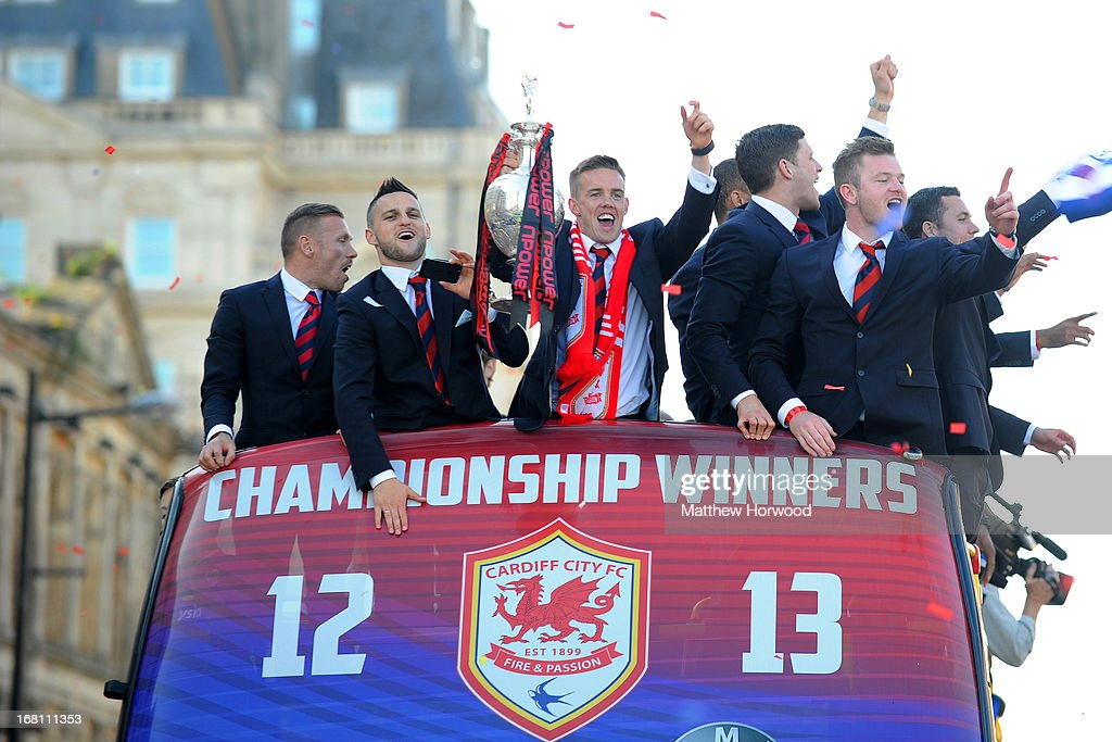 Craig Noone of Cardiff City FC holds the trophy aloft as he and team-mates ride in an open top bus through the city centre during a victory parade in honour of the football club winning the npower Championship League trophy on May 05, 2013 in Cardiff, Wales.