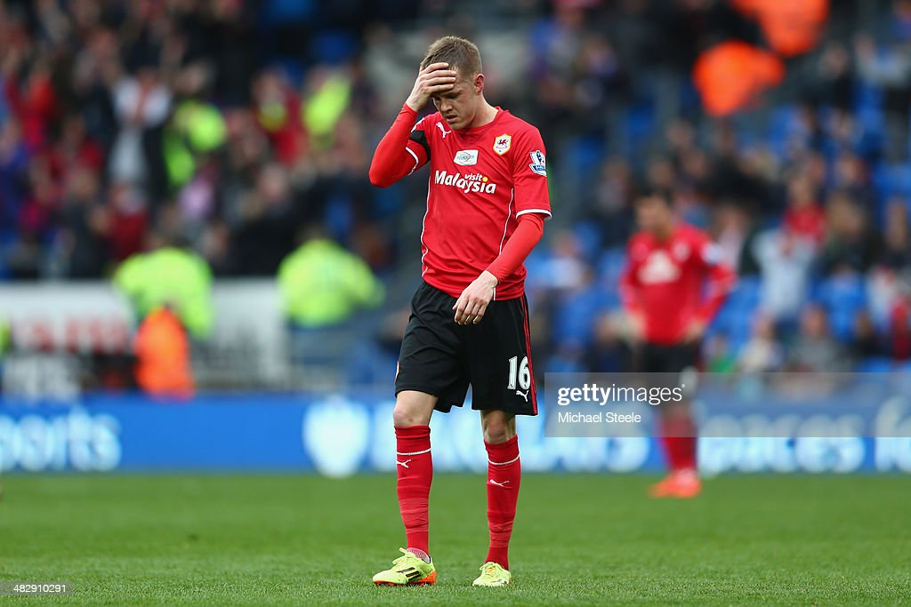 Craig Noone of Cardiff City is a dejected figure after his side concede the third goal during the Barclays Premier League match between Cardiff City and Crystal Palace at Cardiff City Stadium on April 5, 2014 in Cardiff, Wales.