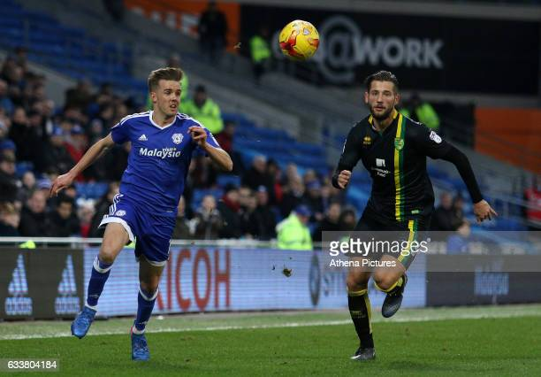 Craig Noone of Cardiff City is closely marked by Mitchell Dijks of Norwich City during the Sky Bet Championship match between Cardiff City and...
