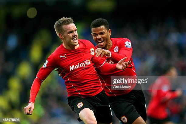 Craig Noone of Cardiff is congratulated by teammate Fraizer Campbell after scoring a goal to level the scores at 11 during the Barclays Premier...