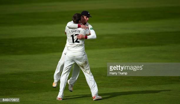 Craig Overton of Somerset and Tom Abell of Somerset celebrates after dismissing Steven Croft of Lancashire during Day Two of the Specsavers County...