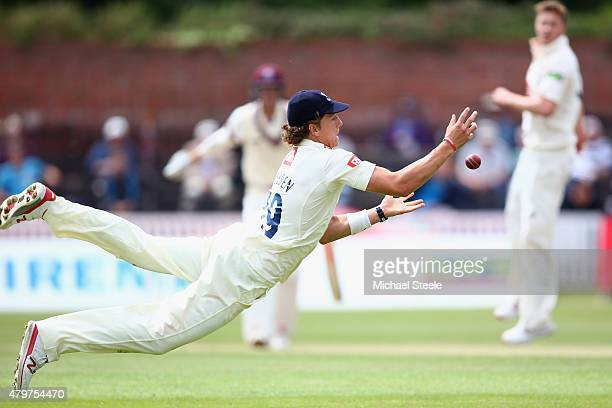 Craig Overton of Somerset survives as Matthew Hobden of Sussex fails to hold onto a diving catch at mid off from the bowling of Oliver Robinson...