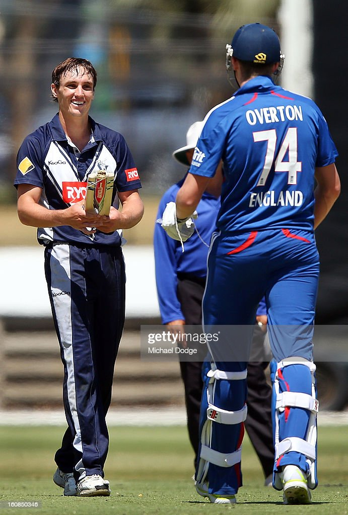 Craig Overton of the England Lions gets handed his broken bat back by Will Sheridan of Victoria during the International tour match between the Victorian 2nd XI and the England Lions at Junction Oval on February 7, 2013 in Melbourne, Australia.
