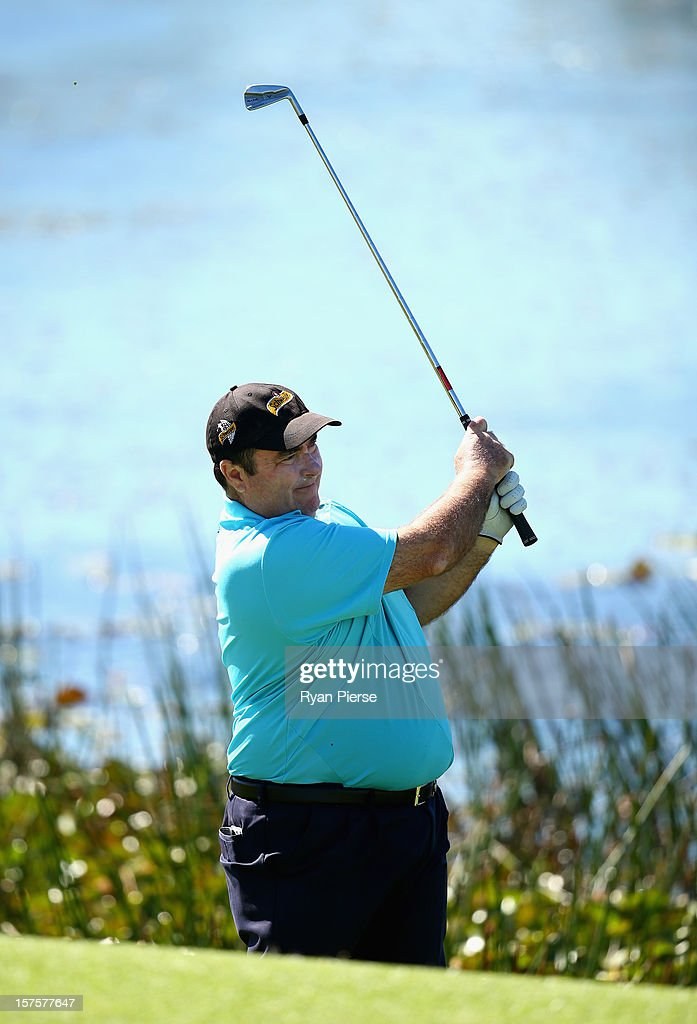 Craig Parry of Australia hits an iron shot during the Pro-Am ahead of the 2012 Australian Open, beginning tomorrow, at The Lakes Golf Club on December 5, 2012 in Sydney, Australia.