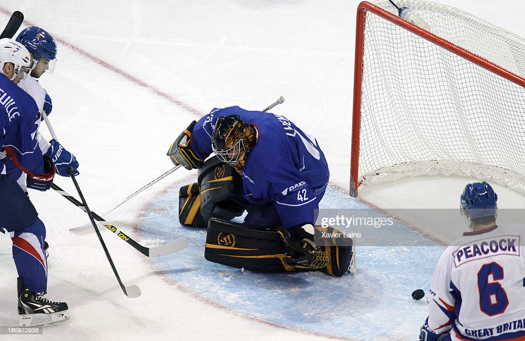 Craig Peacock of Great Britain scores a goal during the Sochi 2014 Olympic Ice Hockey Qualification match between France and Great Britain at Riga Arena on February 8, 2013 in Riga, Latvia.