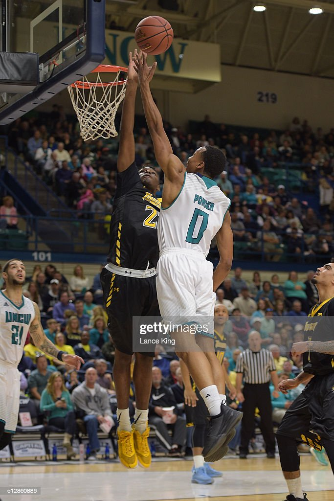 Craig Ponder of the North CarolinaWilmington Seahawks goes to the basket against Mike Morsell of the Towson Tigers at Trask Coliseum on February 27...
