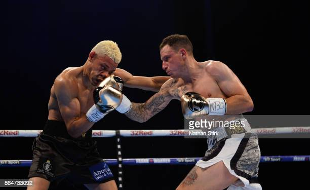 Craig Poxton lands a shot on Leon Woodstock during The Vacant WBO European Super Featherweight Championship Fight at First Direct Arena Leeds on...