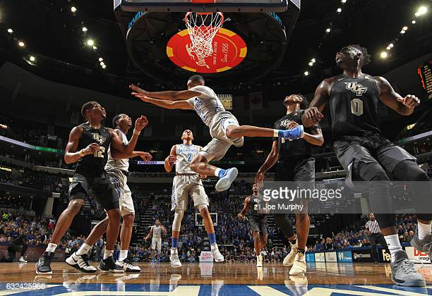 Craig Randall II of the Memphis Tigers has the ball stripped as he drives to the basket against the Central Florida Knights on January 22 2017 at...