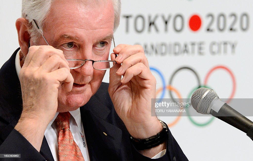 Craig Reedie, chief of the International Olympic Committee (IOC) evaluation commission adjusts his glasses as he answers questions during a press conference in Tokyo on March 7, 2013. The 14-member IOC team, evaluating bids by Tokyo, Madrid and Istanbul for the event, heard presentations on security, medical services and environment on the final day of a four-day inspection tour. AFP PHOTO/Toru YAMANAKA