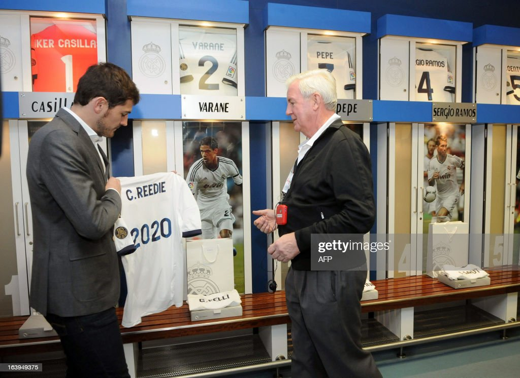 Craig Reedie (R), chief of the International Olympic Committee (IOC) evaluation commission, poses with Real Madrid's goalkeeper and captain Iker Casillas (L) during the IOC evaluation team's visit to the Santiago Bernabeu stadium in Madrid on March 18, 2013. Spanish Prime Minister Mariano Rajoy today opened the International Olympic Committee's (IOC) evaluation team's visit to Madrid by claiming the city deserves the right to host the 2020 Olympic Games. The evaluation committee will visit sites across the city for the next three days before filing their report to IOC members.