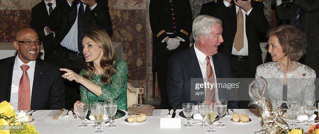Craig Reedie (2nd R), chief of the International Olympic Committee (IOC) evaluation commission, speaks with Spanish Queen Sofia (R) while former Namibian athlete and member of the IOC evaluation team Frank Fredericks (L) speaks with Spanish Prince letizia during an official dinner at the Royal Palace in Madrid on March 20, 2013. The president of Madrid's bid to host the 2020 Olympics, Alejandro Blanco said today he expects the Spanish capital will receive the highest technical score when the International Olympic Committee (IOC) Evaluation Commission publish their reports all three candidate cities. Tokyo and Istanbul are the other cities in the running for the 2020 Games with a final decision on the host city to be taken in Buenos Aires on September 7.