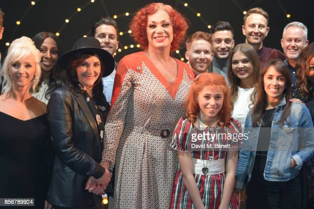 Craig Revel Horwood and Ruby Stokes pose backstage with Strictly Come Dancing cast including Debbie McGee Alexandra Burke Shirley Ballas Brian Conley...