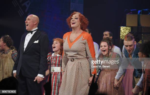Craig Revel Horwood bows onstage at the curtain call with cast members including Alex Bourne Ruby Stokes and Jonny Fines during the cast change press...