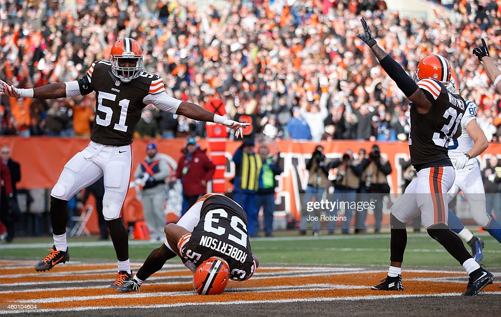 Craig Robertson of the Cleveland Browns recovers a fumble for a touchdown while Barkevious Mingo and Donte Whitner celebrate during the first quarter...