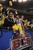 Craig Roh of the Michigan Wolverines celebrates with fans in the stands after they won 2320 in overtime against the Virginia Tech Hokies during the...