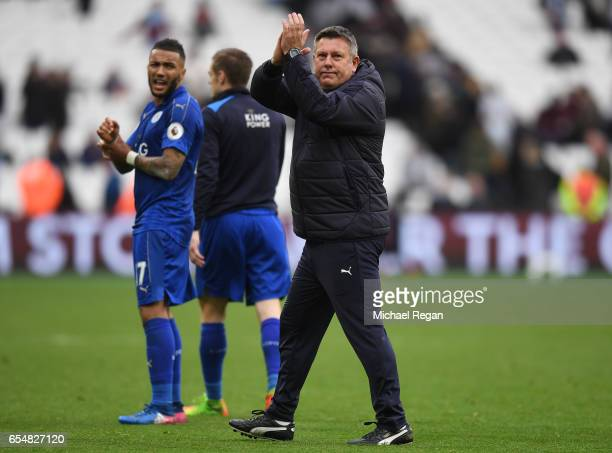 Craig Shakespeare manager of Leicester City shows appreciation to the fans after the Premier League match between West Ham United and Leicester City...