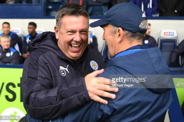 Craig Shakespeare Manager of Leicester City smiles with Tony Pulis Manager of West Bromwich Albion during the Premier League match between West...