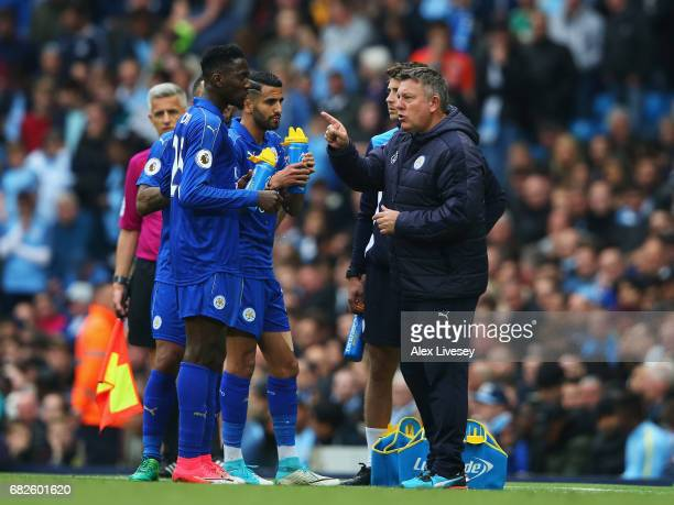 Craig Shakespeare manager of Leicester City speaks to Wilfred Ndidi of Leicester City and Riyad Mahrez of Leicester City during the Premier League...