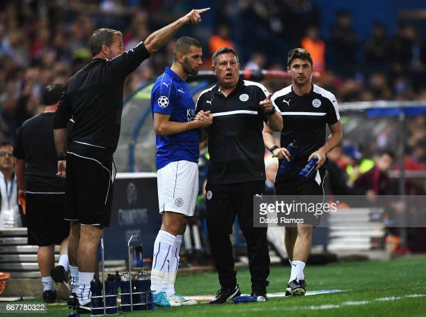 Craig Shakespeare Manager of Leicester City talks to substitute Islam Slimani during the UEFA Champions League Quarter Final first leg match between...