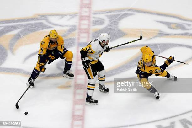 Craig Smith and Calle Jarnkrok of the Nashville Predators skates against Carter Rowney of the Pittsburgh Penguins during the first period in Game Six...