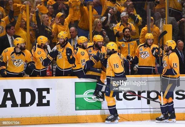 Craig Smith and PK Subban of the Nashville Predators celebrate with teammates after Smith scored a goal during the third period of Game Three of the...