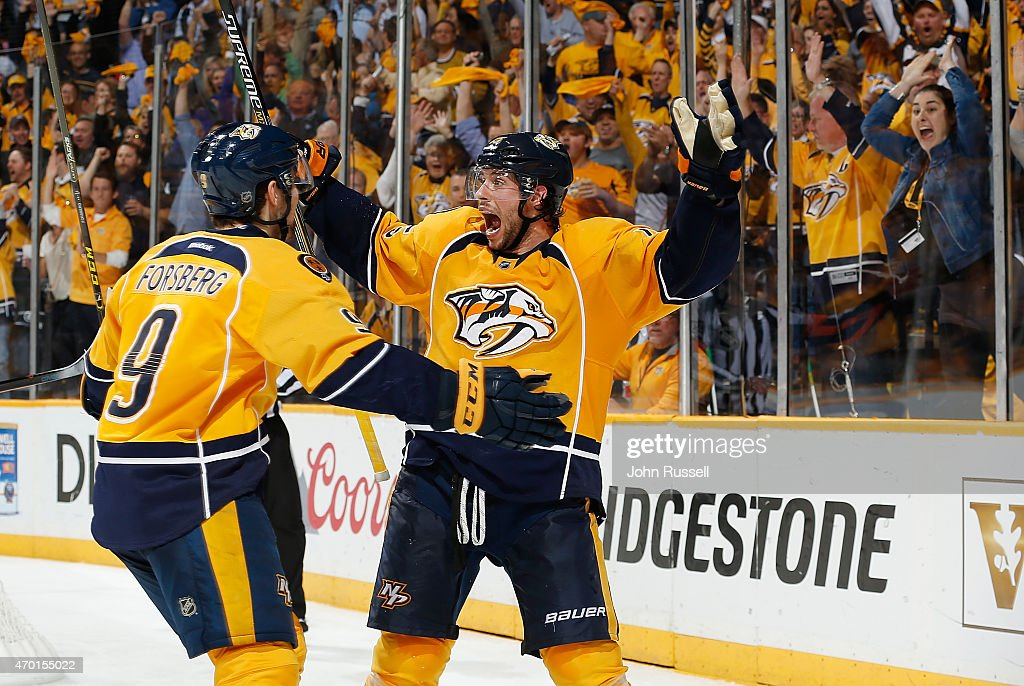 Craig Smith #15 celebrates a goal with Filip Forsberg #9 of the Nashville Predators against the Chicago Blackhawks in Game Two of the Western Conference Quarterfinals during the 2015 NHL Stanley Cup Playoffs at Bridgestone Arena on April 17, 2015 in Nashville, Tennessee.