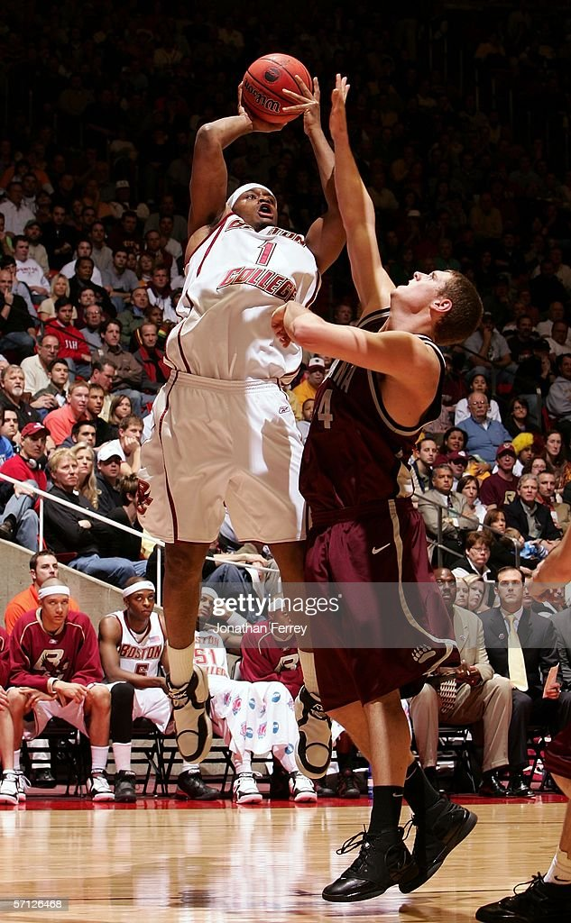 Craig Smith of the Boston College Eagles attempts a shot against Andrew Strait of the Montana Grizzlies during the Second Round of the 2006 NCAA...
