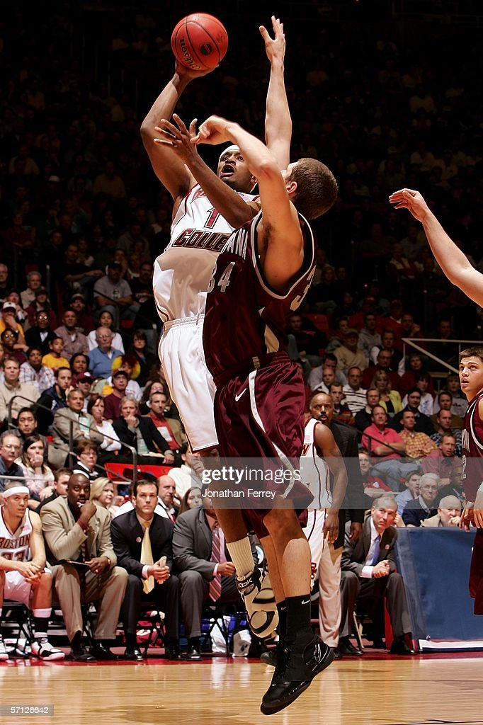 Craig Smith of the Boston College Eagles drives for a shot attempt against Andrew Strait of the Montana Grizzlies during the Second Round of the 2006...