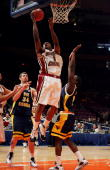 Craig Smith of the Boston College Golden Eagles attempts a shot between Kevin Pittsnogle and Frank Young of the West Virginia Mountaineers during the...