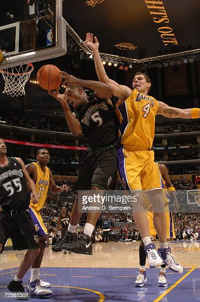 Craig Smith of the Minnesota Timberwolves grabs a rebound against Luke Walton of the Los Angeles Lakers during the game at Staples Center on November...